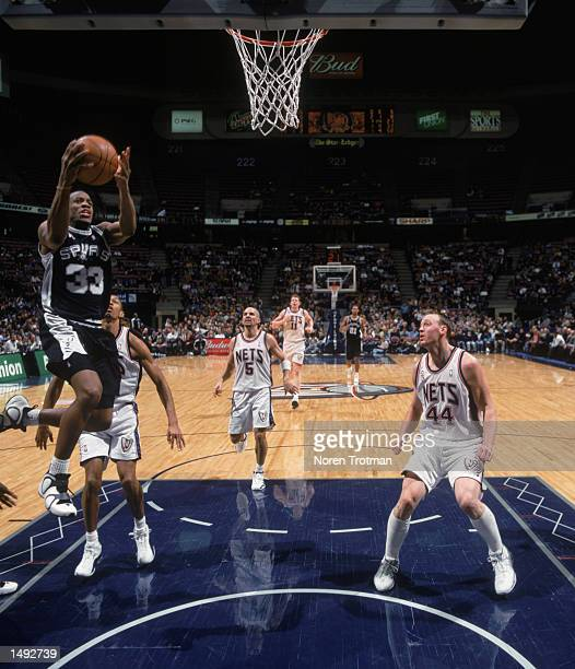 Point guard Antonio Daniels of the San Antonio Spurs shoots a layup during the NBA game against the New Jersey Nets at Continental Airlines Arena in...