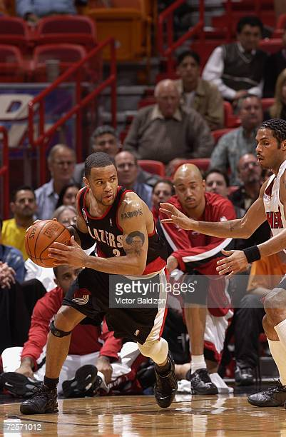 Point guard Damon Stoudamire of the Portland Trail Blazers drives past guard Eddie House of the Miami Heat during the NBA game at American Airlines...