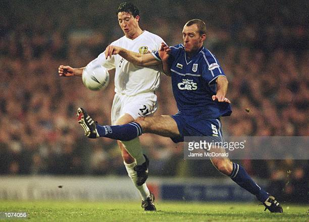 Robbie Fowler of Leeds United has his route to goal blocked off by Spencer Prior of Cardiff City during the AXA sponsored FA Cup third round match...