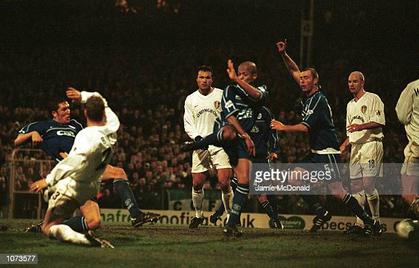 Scott Young of Cardiff scores the winning goal during the AXA FA Cup Third Round match between Cardiff City and Leeds United at Ninian Park Cardiff...