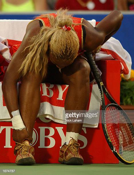 Serena Williams of the United States after injuring her right ankle during her semi final against Meghann Shaughnessy of United States during day 6...