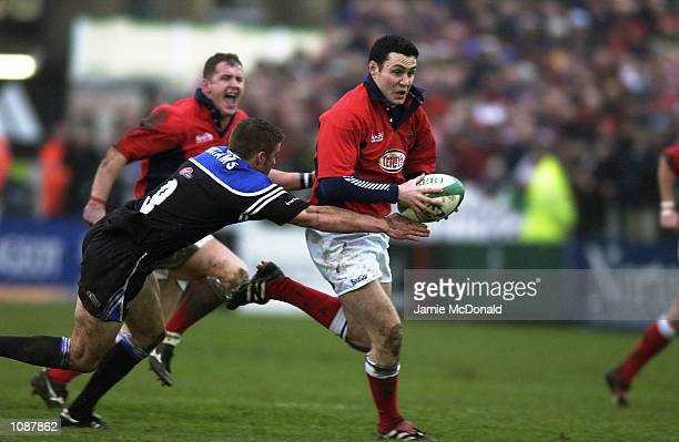 Stephen Jones of Llanelli is tackled by Andy Williams of Bath during the Heineken Cup quarter final game between Bath and Llanelli at the Recreation...
