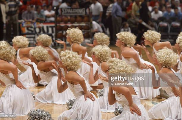 The Reagan High School Dance Team performs while dressed up as Marilyn Monroe during the halftime show of the San Antonio Spurs and New Jersey Nets...