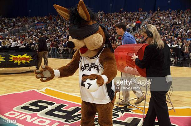 The Spurs Coyote draws the winning number 7 in a lottery to see which fans will receive a Coyote Bobblehead doll during halftime of the New York...