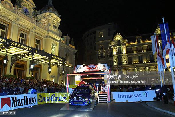 Tommi Makinen of Finland driving a Subaru Impreza at the start of the Monte Carlo Rally the first stage of the 2002 World Rally Championship DIGITAL...