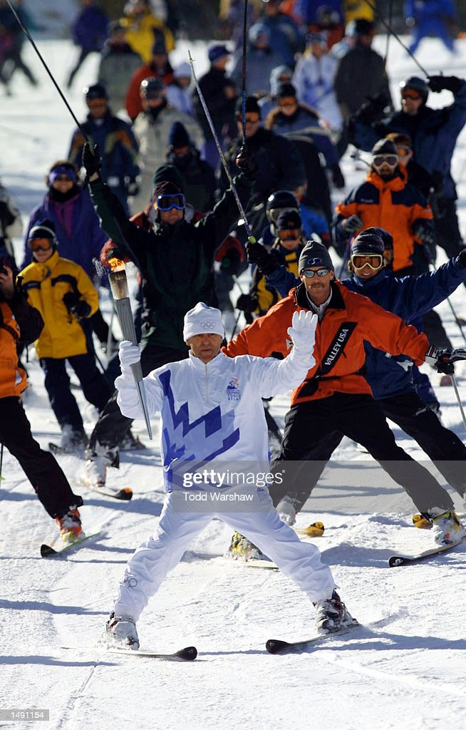 Torchbearer Osvaldo Ancinas skis with the Olympic Flame during the 2002 Salt Lake Olympic Torch Relay in Squaw Valley, California. DIGITAL IMAGE. Mandatory Credit: Todd Warshaw/Pool/Getty Images