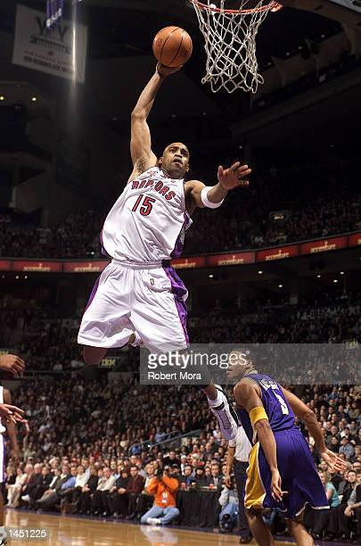 Vince Carter of the Toronto Raptors gets to the basket past two Los Angeles Lakers during a game at the Air Canada Centre in Toronto Canada DIGITAL...