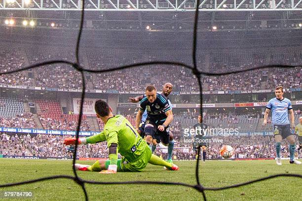 Besart Berisha of Melbourne Victory attempts a shot on goal with Vedran Janjetovic of Sydney FC deflecting the shot during the 16th round of the...