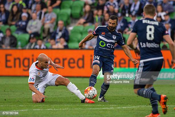 Fahid Ben Khalfallah of Melbourne Victory and Steven Lustica of the Brisbane Roar contest the ball during the 15th round of the 201516 Hyundai...