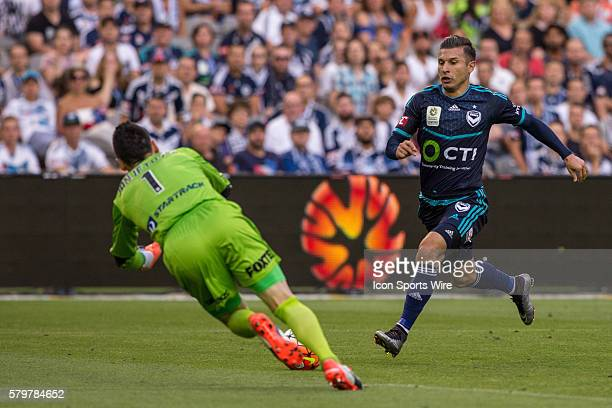 Kosta Barbarouses of Melbourne Victory gets denied by Vedran Janjetovic of Sydney FC during the 16th round of the 201516 Hyundai ALeague Season...