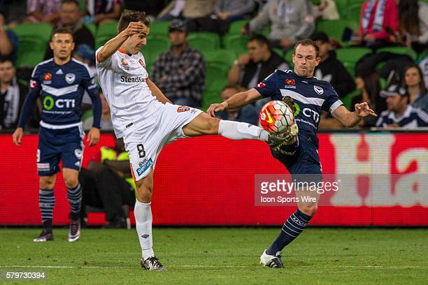 Steven Lustica of the Brisbane Roar and Leigh Broxham of Melbourne Victory contest the ball during the 15th round of the 201516 Hyundai ALeague...