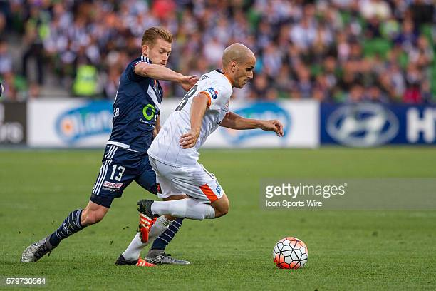 Steven Lustica of the Brisbane Roar and Oliver Botanic of Melbourne Victory contest the ball during the 15th round of the 201516 Hyundai ALeague...