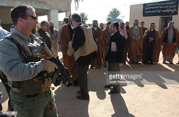 Jan 25 American Blackwater security guards protect American diplomats as they meet with Iraqi Shiites of the large Bani Hassan tribe and its new head...