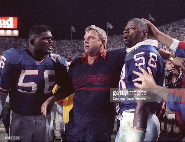 Jan 27 1991 Tampa Florida USA Celebration New York Giants head coach BILL PARCELLS LAWRENCE TAYLOR CARL BANKS against Buffalo Bills in Super Bowl 25...