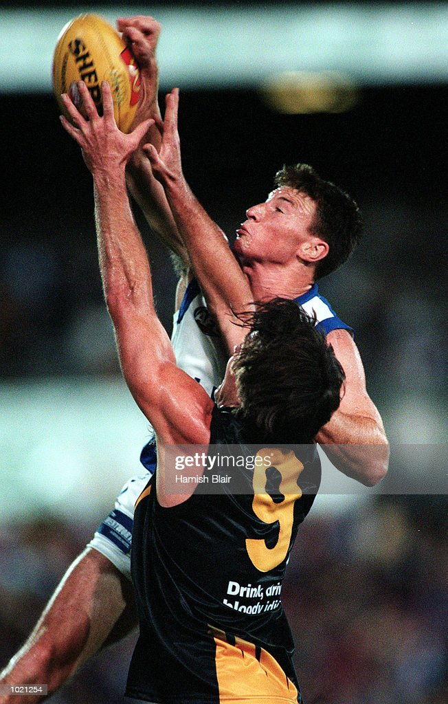 Brent Harvey of the Kangaroos spoils a marking attempt by Wayne Campbell of Richmond, during the pre season Ansett Cup match between the Kangaroos and Richmond at Waverley Park, Melbourne, Australia. Mandatory Credit: Hamish Blair/ALLSPORT