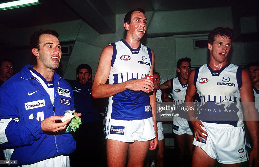 New recruits to the Kangaroos (l - r) David Calthorpe, Matthew Burton and Leigh Colbert join in the team song, after the pre season Ansett Cup match between the Kangaroos and Richmond at Waverley Park, Melbourne, Australia. Mandatory Credit: Hamish Blair/ALLSPORT