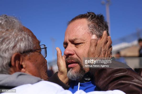 A man reacts during an event called 'Hugs not Walls' at the banks of the river Rio Bravo a natural border between the US and Mexico in Ciudad Juarez...