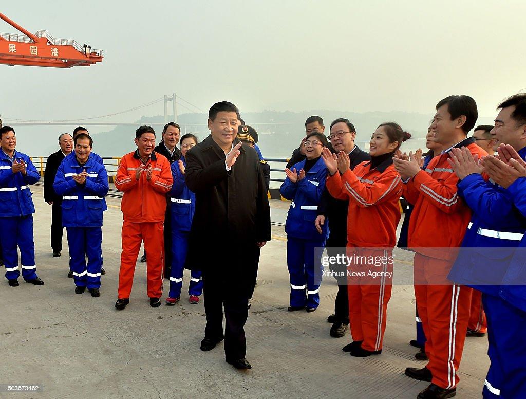 CHONGQING Jan 6 2016 Chinese President Xi Jinping center greets workers during his visit to Guoyuan Port in southwest China's Chongqing Municipality...
