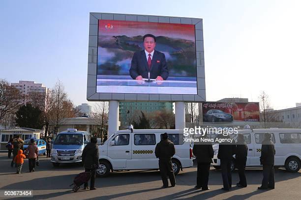PYONGYANG Jan 6 2016 Photo taken on Jan 6 2016 shows Pyongyang citizens gathering in front of a big screen at Pyongyang Railway Station in Pyongyang...
