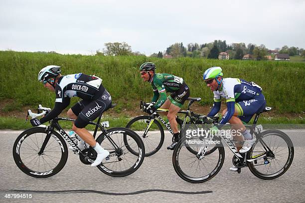 Jan Bakelants of Belgium and Omega PharmaQuick Step sets the pace in a breakaway group followed byThomas Voeckler of France and Team Europcar and...