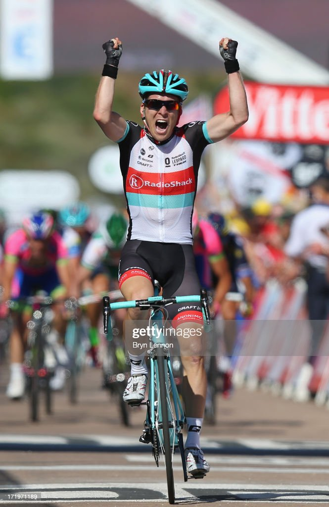 Jan Bakelants of Belgium and Radioshack Leopard celebrates as he crosses the finishing line to win stage two of the 2013 Tour de France, a 156KM road stage from Bastia to Ajaccio, on June 30, 2013 in Ajaccio, France.