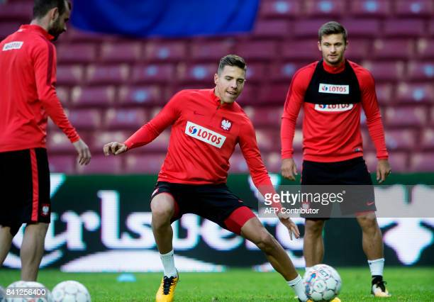Jan Bednarek and Karol Linetty of the Polish national football team take part in a trainig session on the eve of their FIFA World Cup 2018...