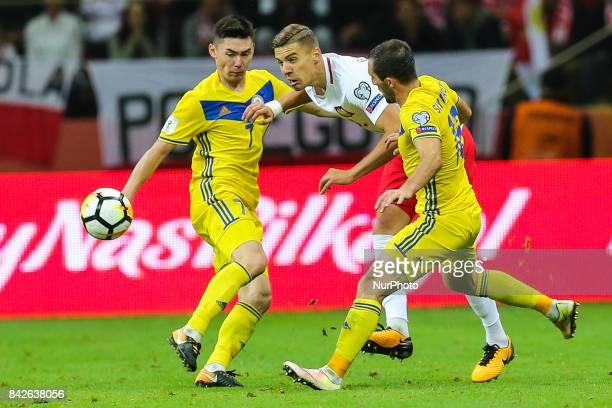 Jan Bednarek Aslan Barabaev Gafurzhan Suyumbayev during the FIFA World Cup 2018 qualification match between Poland and Kazakhstan in Warsaw on...