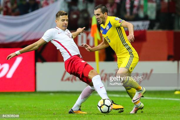 Jan Bednarek Gafurzhan Suyumbayev during the FIFA World Cup 2018 qualification match between Poland and Kazakhstan in Warsaw on September 4 2017