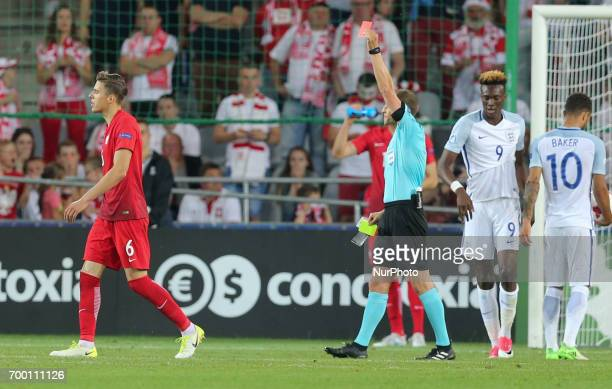 Jan Bednarek of Poland is shown a red card during the UEFA European Under21 Championship Group A match between England and Poland at Kielce Stadium...