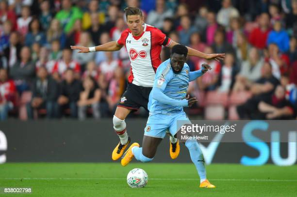 Jan Bednarek of Southampton and Nouha Dicko of Wolverhampton Wanderers battle for possession during the Carabao Cup Second Round match between...