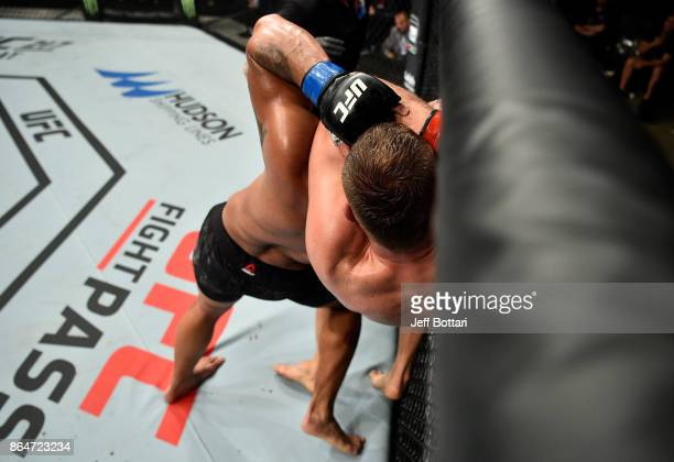 Jan Blachowicz of Poland secures a rear choke submission against Devin Clark in their light heavyweight bout during the UFC Fight Night event inside...