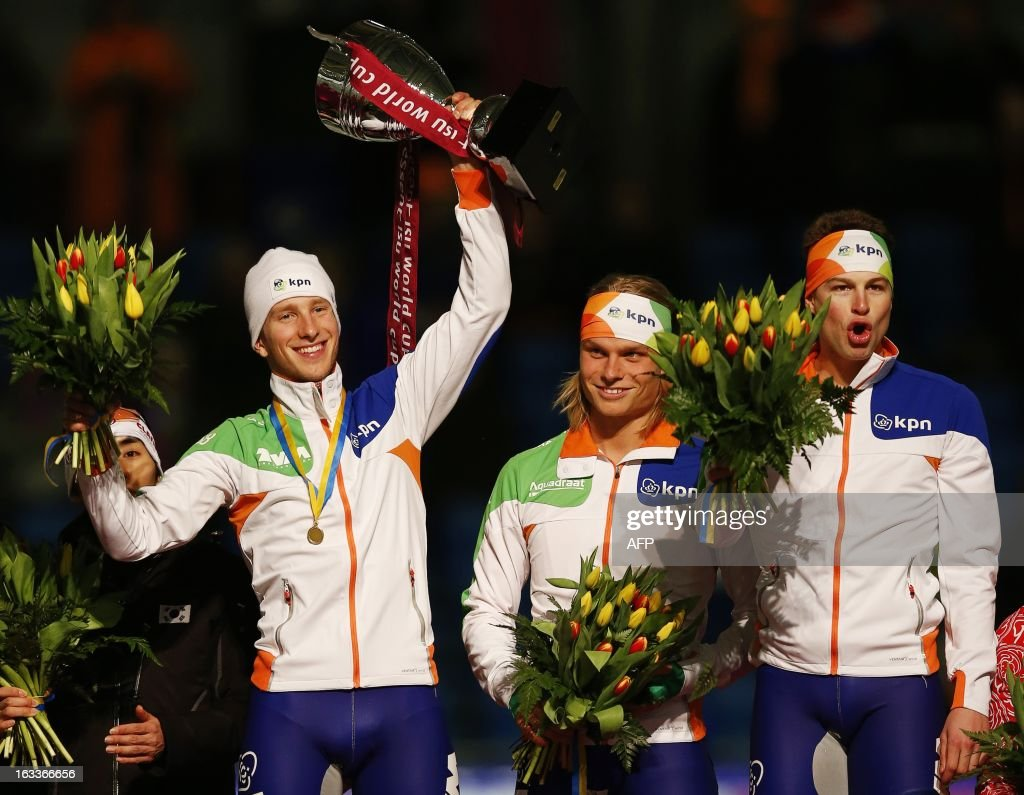 Jan Blokhuijsen, Koen Verweij and Sven Kramer of the Netherlands celebrate on the podium after winning the team pursuit race of the Speed Skating World Cup at the Thialf stadium in Heerenveen, on March 8, 2013.