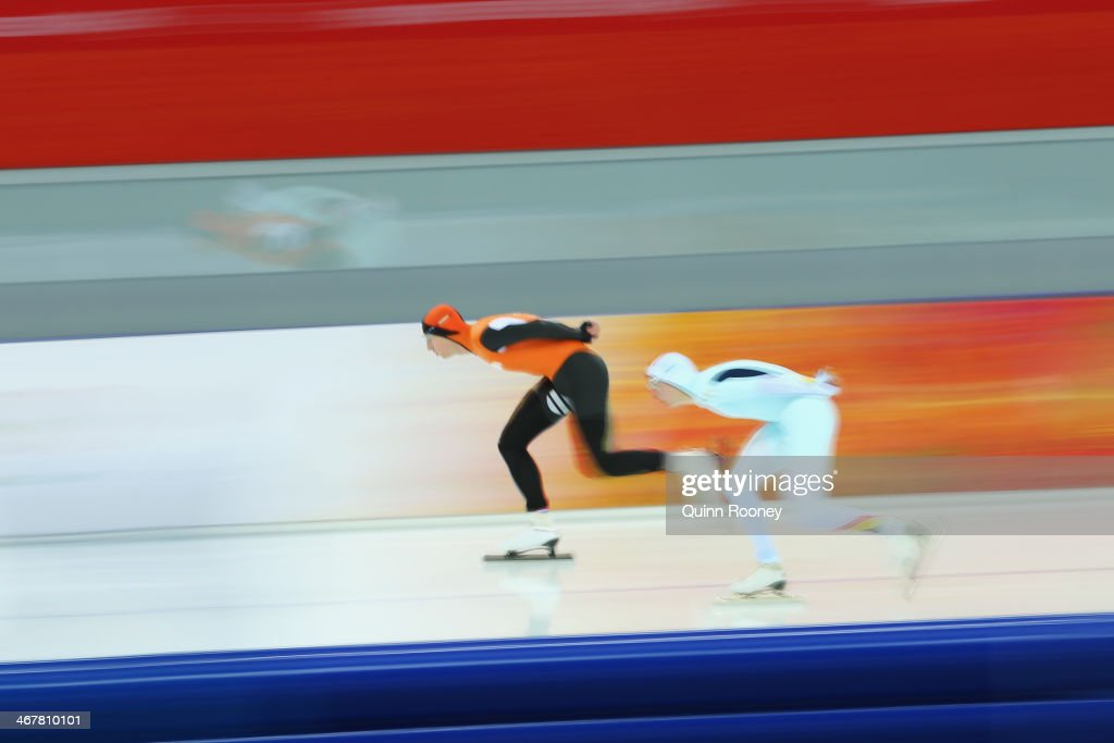 <a gi-track='captionPersonalityLinkClicked' href=/galleries/search?phrase=Jan+Blokhuijsen&family=editorial&specificpeople=4900694 ng-click='$event.stopPropagation()'>Jan Blokhuijsen</a> (L) of the Netherlands and <a gi-track='captionPersonalityLinkClicked' href=/galleries/search?phrase=Bart+Swings&family=editorial&specificpeople=7294720 ng-click='$event.stopPropagation()'>Bart Swings</a> of Belgium compete during the Men's 5000m Speed Skating event during day 1 of the Sochi 2014 Winter Olympics at Adler Arena Skating Center on February 8, 2014 in Sochi, Russia.