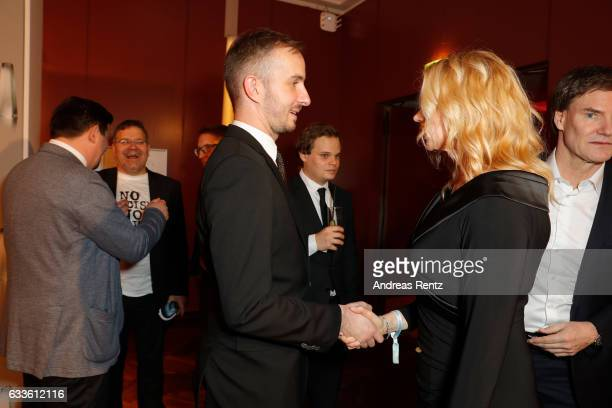Jan Boehmermann chats with Veronica Ferres during the German Television Award at Rheinterrasse on February 2 2017 in Duesseldorf Germany