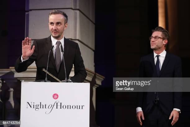 Jan Boehmermann speaks after receiving the award for ADC Honourary Member 2016 as journalist Matthias Kalle of Die Zeit looks on at the ADC Night of...