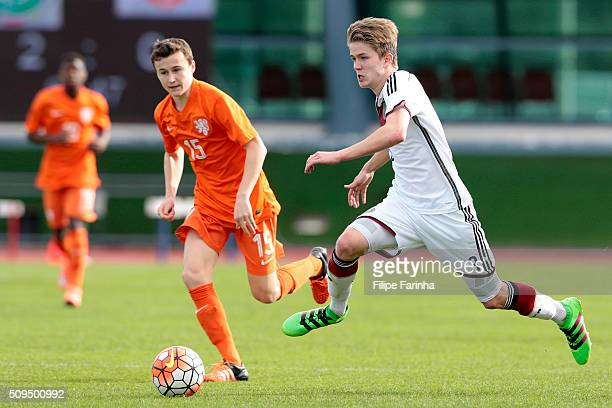 Jan Boller of Germany challenges Peer Koopmeiners of Netherlands during the UEFA Under16 match between U16 Germany v U16 Netherlands on February 8...