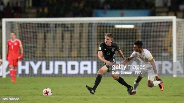 Jan Boller of Germany is challenged by Younes Delfi of Iran during the FIFA U17 World Cup India 2017 group C match between Iran and Germany at Pandit...