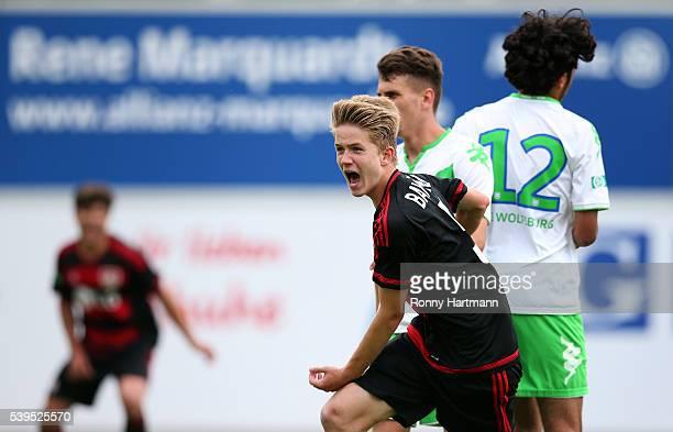 Jan Boller of Leverkusen celebrates after scoring his team's third goal infront of Abdallah ElHaibi of Wolfsburg during the U17 German Championship...