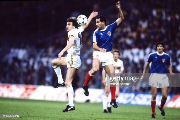 Jan Ceulemans of Belgium and Nenad Stojkovic of Yugoslavia during the European Championship match between Belgium and Yugoslavia at La Meinau in...