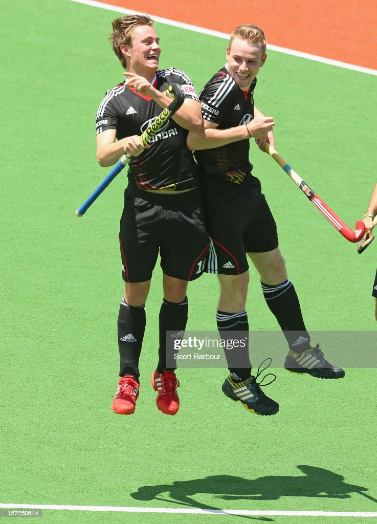 Jan Christopher Ruehr (R) of Germany celebrates after scoring a goal during the match between Germany and New Zealand on day one of the Champions Trophy on December 1, 2012 in Melbourne, Australia.