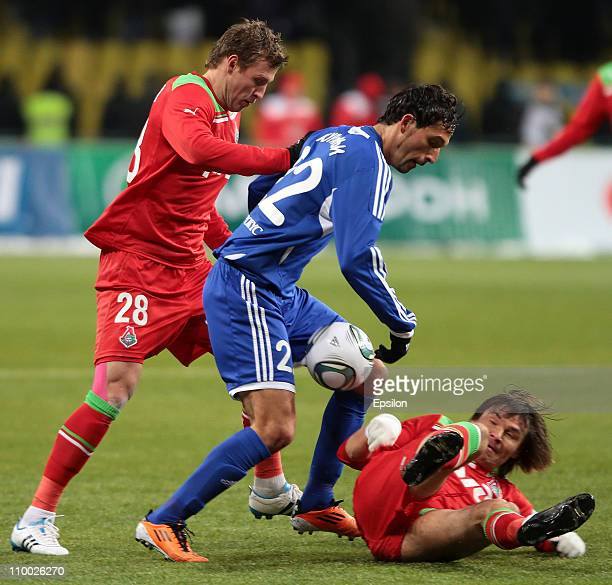 Jan Durica and Dmitri Loskov of FC Lokomotiv Moscow compete for the ball with Kevin Kuranyi of FC Dynamo Moscow during the Russian Premier League...