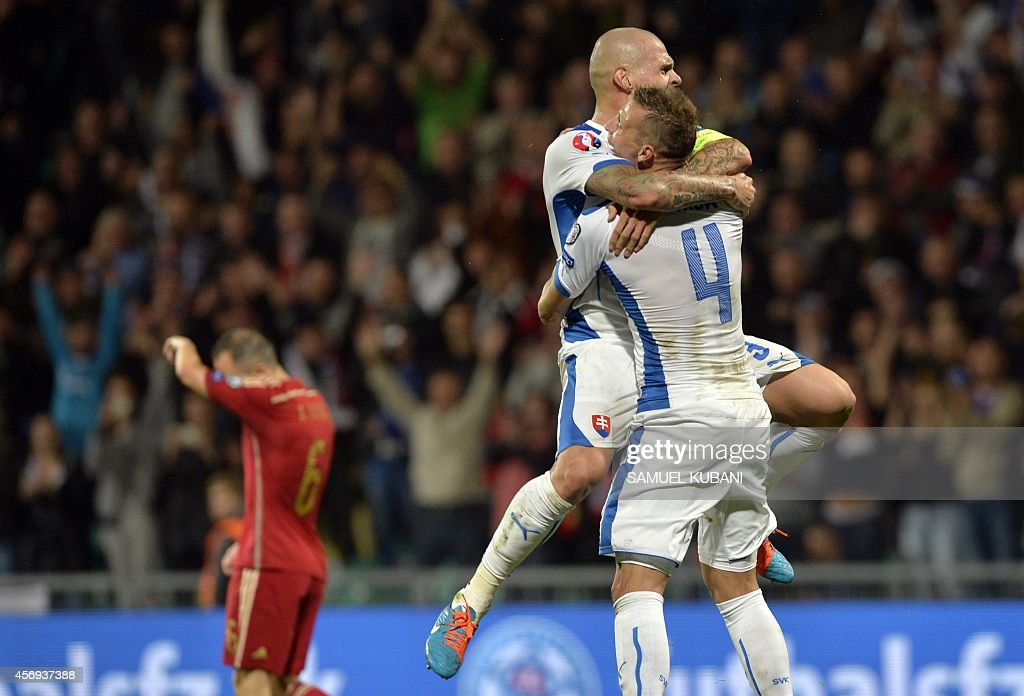 Jan Durica and Martin Skrtel of Slovakia celebrate their goal during Euro 2016 qualifing football match between Slovakia and Spain in northern Slovak...