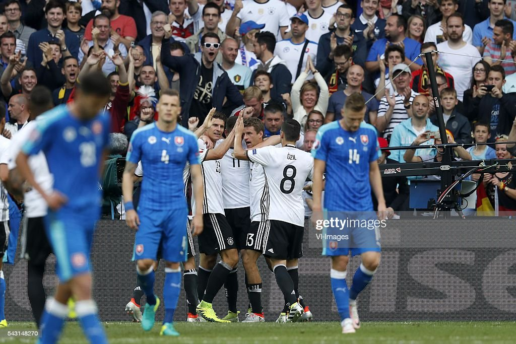 Jan Durica of Slovakia, Mario Gomez of Germany, Julian Draxler of Germany, Thomas Muller of Germany, Mesut Ozil of Germany, Milan Skriniar of Slovakia during the UEFA Euro 2016 round of 16 match between Germany and Slovakia on June 26, 2016 at the stade Pierre-Mauloy in Lille, France.