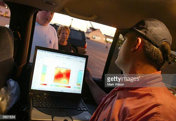 Jan Dutton of the WeatherBugcom talks to passersby as he tracks Hurricane Isabel and gives out updates September 16 2003 in Ocean City Maryland...