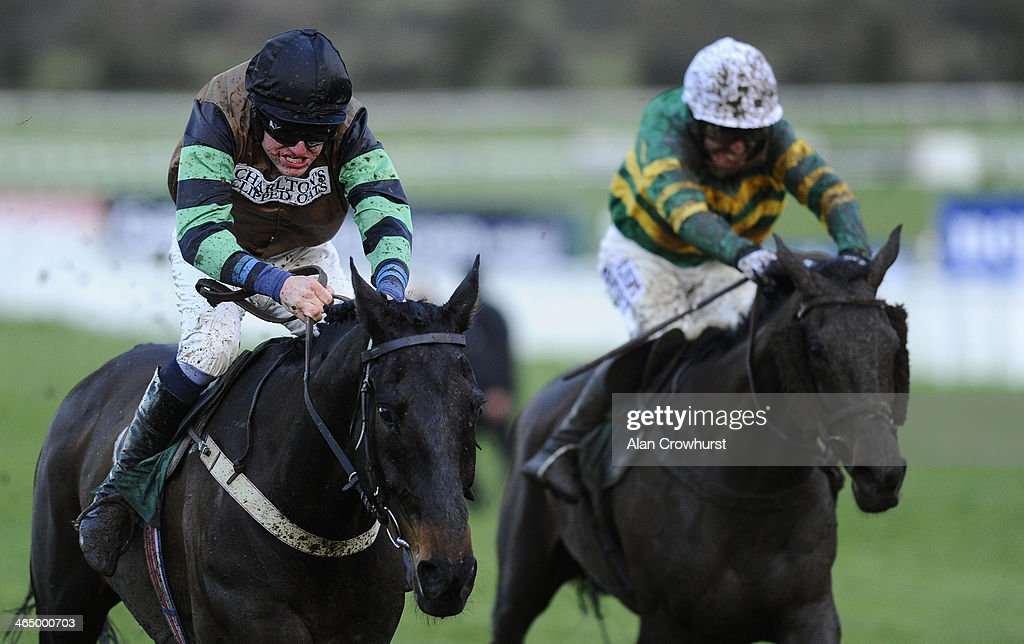 Jan Faltejsek riding Knockara Beau (L) clear the last to win The Cleeve Hurdle from At Fishers Cross (R) at Cheltenham racecourse on January 25, 2014 in Cheltenham, England.