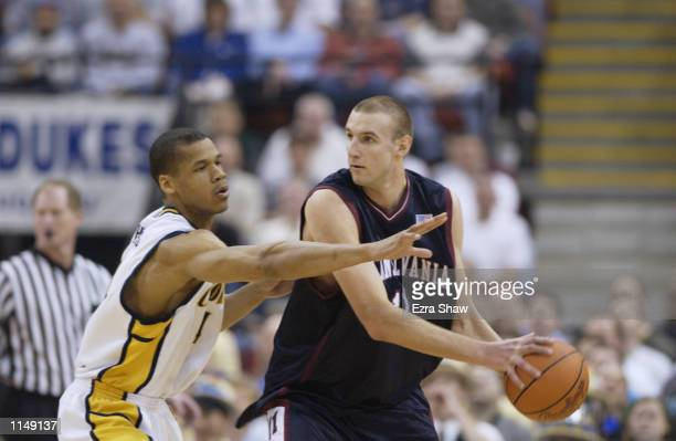 Jan Fikiel of the Pennsylvania Quakers looks to pass around Solomon Hughes of the California Golden Bears during the first round of the 2002 NCAA...