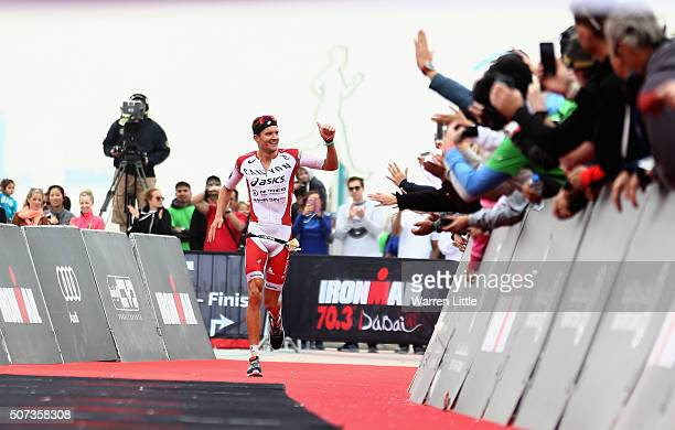 Jan Frodeno of Germany acknowledges the crowd as he wins the Men's IRONMAN 703 Dubai on January 29 2016 in Dubai United Arab Emirates