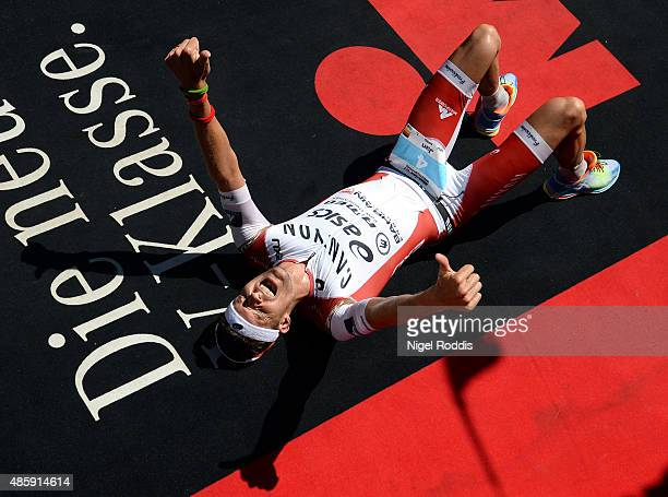 Jan Frodeno of Germany celebrates winning Ironman 703 World Championship on August 30 2015 in Zell am See Austria