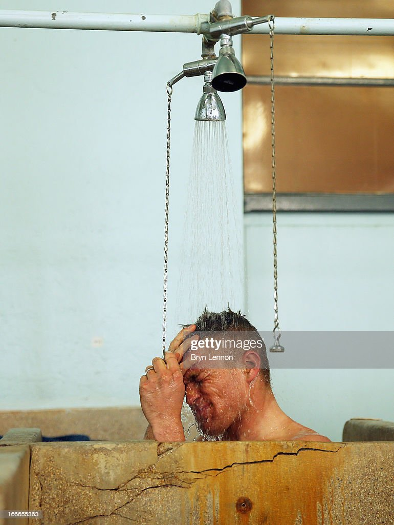 Jan Ghyselinck of Belgium and Cofidis takes a shower in the famous Paris-Roubaix showers after the 2013 Paris - Roubaix race from Compiegne to Roubaix on April 7, 2013 in Roubaix, France. The 111th Paris - Roubaix race is 254km long and contains 27 sections of cobblestones.