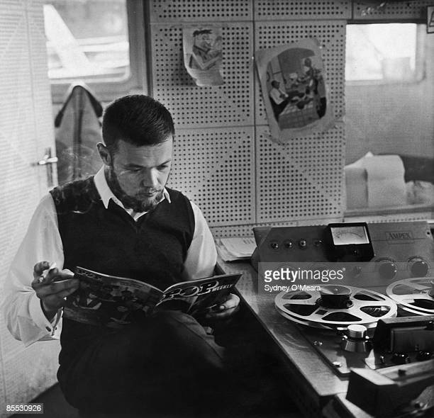Jan Gunnarsson the chief engineer for offshore pirate radio station Radio Caroline reads a copy of 'Pop Weekly' on board ship off the Suffolk coast...